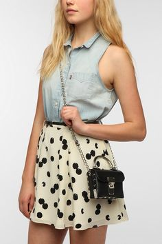 don't like the skirt, but good idea to put jean collared tank top with a skirt!