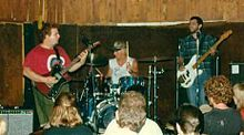 """Minutemen were an American hardcore punk band formed in San Pedro, California in 1980. Composed of guitarist D. Boon, bassist Mike Watt and drummer George Hurley, Minutemen recorded four albums and eight EPs before Boon's death in an automobile accident in December 1985. They were noted in the California punk community for a philosophy of """"jamming econo"""" – a sense of thriftiness reflected in their touring and presentation – while their eclectic and experimental attitude was instrumental in…"""