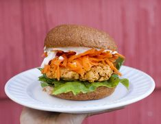 Buffalo Chickpea Burgers from Fo Reals Life {Top with spinach, avocado, and blue-cheese dressing}