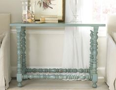 Maybe I could make this?  Balusters, wood plank, and paint.  It is mine.