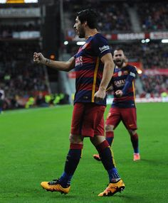 Luis Suarez of FC Barcelona celebrates after scoring his team's 3rd goal during the La Liga match between Sporting Gijon and FC Barcelona at Estadio El Molinon on February 17, 2016 in Gijon