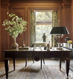 Gary's study is paneled in rift-sawn oak; the curtains are of a Cowtan & Tout print, and the André Arbus desk and Khotan rug are both vintage.