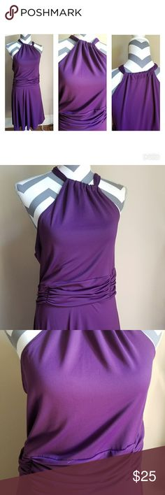 Purple dress with Halter Top Neck Line. Stunning purple dress with a flattering halter top. Midi length. Dresses Midi
