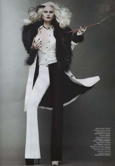 Cruella-like hair and an outfit by Tom Ford