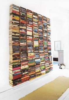 Hometalk :: Floating Book Wall [probably better for decorative purposes at a bookstore but still - very clever! jh]