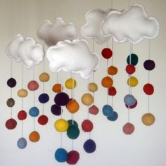 This would work well in the boys room!  (felt clouds and a rainbow of wool)