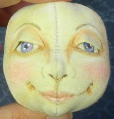 Tutorial on making head at dollmaking class.