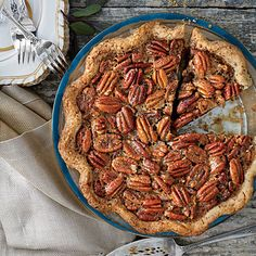 We love the combination of pecans and smoky-sweet bourbon in the thick, rich pie filling. For a booze-free pie, substitute apple juice...