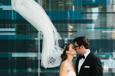 Loving the wind swept veil. Weddings in Toronto by Photographer duo A Brit & A Blonde - abritandablonde.com  Read More: http://www.stylemepretty.com/canada-weddings/2014/08/06/downtown-toronto-restaurant-wedding-at-boehmer/