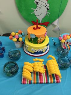 Landon's Seuss Cake, cake pops and lollipops.  Cake- 1 Fish 2 Fish on bottom and the Lorax on top! (Of course I had to get little fishes)   Lorax trees for cake pops   Lorax Mustache lollipops