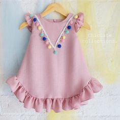Check out my new Pretty Ruffled Short-sleeve Pompon Decor Dress for Baby Girl, snagged at a crazy discounted price with the PatPat app. Baby Dress Design, Baby Girl Dress Patterns, Baby Clothes Patterns, Kids Frocks, Frocks For Girls, Little Girl Dresses, Dress Girl, Little Girl Fashion, Kids Fashion