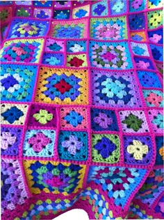 This afghan consists of different size granny squares joined together with a raised stitch. The squares are then bordered with different colours. You are buying a one-of-a-kind (OOAK) blanket. Crocheted by me using 100% acrylic worsted weight yarn, afghan measures approx. 58 in.