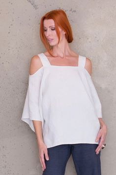 Couture quality, versatile, loose fitting tunic top, with wide shoulder straps. Sleeves fall on forearm.  Perfect top for your next holiday.