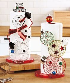 Holiday Paper Towel Holder adds seasonal flair while it organizes your space. It resembles a favorite holiday symbol, innovatively shaped from 3 stacked circles and embellished with shiny accents and colors. Use it to hold paper towels in the kitchen