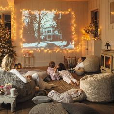 Christmas Decoration - Selected by Koslopolis Magazine - LOVE that they're watching the family stone and that the space is decorated for Christmas and I love the idea of a bean bag room. Cosy Christmas, Christmas Home, Christmas Movies, Hygge Christmas, Holiday Movie, Family Holiday, White Christmas, Christmas Lights, Bean Bag Room