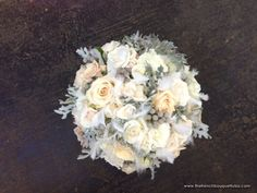 hydrangea, dusty miller, berzilia berries, spray roses, ranunculus, sahara roses (accented with jewels and feathers)