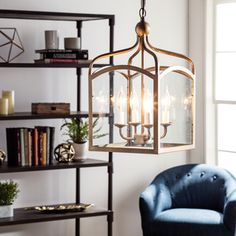Add a traditional touch to your foyer or entryway with this hanging lantern from Ashley. This elegant bronze lantern features four pendant lights that offer excellent illumination. Designed from solid
