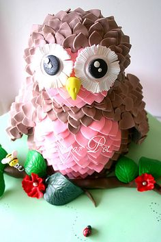 Lovely ideas for an owl themed baby shower. See how a heart cutter has been used to create the feathers. So cute!