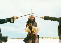 *PIRATES OF THE CARIBBEAN: Dead Man's Chest: Commodore James Norrington, Captain Jack SparrowStill of Johnny Depp in Pirates of the Caribbean: Dead Man's Chest
