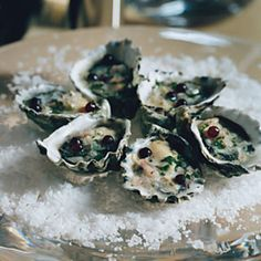 In this elegant introduction to dinner, oysters are paired with Champagne grapes, whose sweet juice balances the sharpness of the vinegar in the mignonnette.