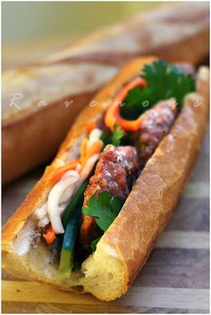 Vietnamese Sandwich with Grilled Pork Patties (Banh Mi Nem Nuong). Aside from pho (Vietnamese beef noodle soup), the banh mi (Vietnamese sandwich/Saigon sub) is arguably the second greatest Vietnamese import into the American food culture. Vietnamese Grilled Pork, Vietnamese Sandwich, Banh Mi Sandwich, Vietnamese Cuisine, Vietnamese Recipes, Pork Recipes, Asian Recipes, Cooking Recipes, Nem Nuong
