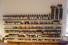 Kottens corner: Scraphouse  Distress ink, stickles, glimmer mist etc storage using 5 ft long picture rails.   I have two more now, even more packed. :)