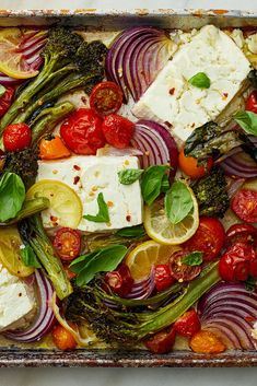 NYT Cooking: When baked, feta gains an almost creamy texture, similar to goat cheese but with feta's characteristic tang. In this easy vegetarian sheet-pan dinner, broccolini (or broccoli), grape tomatoes and lemon slices roast alongside the feta until the broccolini crisp, the tomatoes burst and the lemon rinds soften. (Remember, broccolini has a tender, delicious stalk so only the bottom 1/2-inch needs to... Vegetarian Main Dishes, Vegetarian Entrees, Vegetable Dishes, Lemon Recipes, Vegetable Recipes, Feta, Cooking Recipes, Healthy Recipes, Popular Recipes