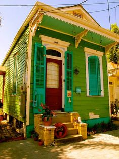A tiny bright shotgun-style house in New Orleans