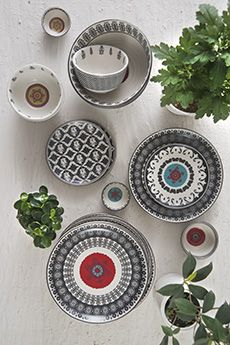 BLACK, WHITE & SUZANI Our 'Anatolia' #HandThrown #stoneware is inspired by the traditional graphic motifs of glorious hand embroidered #suzanis from the #SilkRoute. The collection includes plates and bowls in varying sizes that are perfect for canapé service and informal dining. From nuts to pickles, salad to soup and pizza to cake, these versatile pieces serve in style. Shop the 'Anatolia' design story on our #WebBoutique .