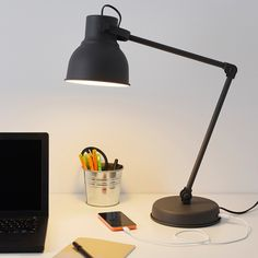 HEKTAR Work lamp with LED bulb IKEA You can charge your mobile phone or other devices through the built-in USB port in the lamp. Hektar Ikea, Usb, Black Desk Lamps, White Lamps, Study Lamps, Study Desk, Work Lamp, Old Lamps, Desk Light