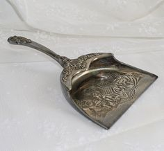I could use a crumb catcher. all that's missing is the brush-Silver Plate Silent Butler Crumb Catcher Godinger GSA. $18.00, via Etsy.