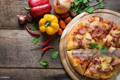 Stock Photo : High Angle View Of Pizza On Wooden Table