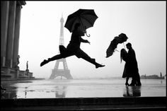 """Elliott Erwitt on Elliott Erwitt - LightBox: """"This is turning out to be one of my better pictures. It's a guy with an umberella jumping with the Eiffel Tower in the background. It's the cover of my recently published """"Paris"""" book. This picture was taken about 15 years ago. I don't remember whether we had a rainstorm or if we created it. Was it for the Board of Tourism? Actually, you'd never have rain for [the Board of Tourism] unless it was in a rainforest."""" #Elliott_Erwitt"""