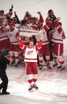 Steve Yzerman lifts the Stanley Cup, 1997. More than happy for Detroit I think everyone was truly happy for Stevie Y!! Great sports memory!