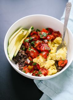 This hearty breakfast bowl features Tex-Mex flavors, including pico de gallo, avocado and black beans - cookieandkate.com