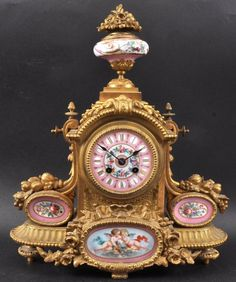 A 19th Century French Ormolu Mantle Clock Painted With Pink Sevres Panels.