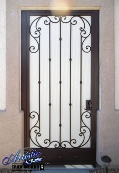 Wrought iron entryway with scrolls, knuckles, kick plate and perforated metal backing