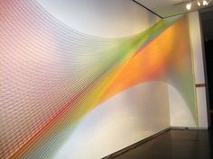 "Mexican artist Gabriel Dawe makes all kinds of wondrous things with basic textiles. His ongoing series, Plexus, is a collection of unique, complex structures that form intricate patterns of color with sewing thread. The artist says he builds the site-specific installations to ""explore the connection between fashion and architecture, and how they relate to the human need for shelter in all its shapes and forms."" In each Plexus installation, thousands of single strands are hooked into walls…"