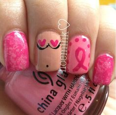 Breast Cancer Awareness nails. The boobies are an awesome and unique touch :)