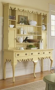 Paint hutch a very pale creamy yellow, and the walls a slate gray/dark marine blue