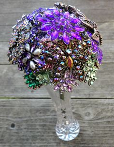 This is very glitzy blingy to me. Looks like all the brooches were bought at Sam Moon's. I like the colors though.