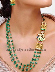 Jewellery Designs: Emerald Beads Set with Peacock Motif