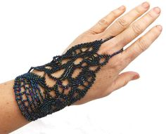 Free form slave bracelet. Multi blue metallic beadwork. A very strong & comfortable elastic ring bracelet, for daily use. Facebook: www.facebook.com/slavebracelets One of a kind! Slavebracelet. Handchain. Fingerbracelet. Handjewelry. Ringbracelet. Handbracelet. Handpiece. Handjewellery Handflower