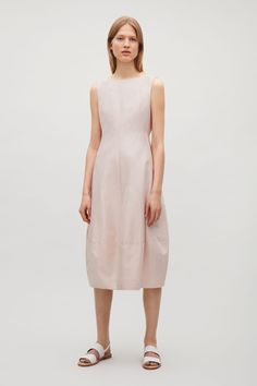 COS image 1 of Sleeveless dress with cocoon skirt in Biscuit