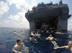 GULF OF ADEN (April 18, 2015) – Sailors and Marines aboard the amphibious assault ship USS Iwo Jima (LHD 7) participate in a swim call. Iwo Jima is the flagship for the Amphibious Ready Group (ARG) and, with the embarked 24th Marine Expeditionary Unit (MEU), provides a versatile sea-based, expeditionary force that can be tailored to a variety of missions in the U.S. 5th Fleet area of operations.
