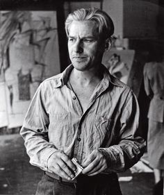 Willem de Kooning in his Fourth Avenue studio with drawings related toWoman Iin the background, 1950; photograph by Rudy Burckhardt. Artwork by Willem de Kooning © 2014 The Willem de Kooning Foundation/Artists Rights Society, (ARS), New York