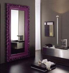 If you do a grey wall, a colored frame  mirror might be good idea since the living room doesn't have any direct light.