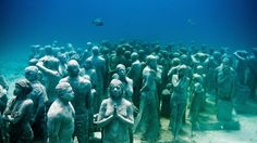 9 Incredible Underwater Attractions (PHOTOS) -  A series of over 500 life-sized underwater sculptures by artist Jason deCaires Taylor, comprise Isla Mujeres National Marine Park of the coast of Mexico's Yucatan Peninsula. weather.com