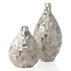 on hearth with floor vase (on floor) next to them.  Colors are great and will stand out against the stone or darker accent color.Tempest Vase from Z Gallerie