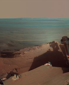 """Late Afternoon Shadows at Endeavour Crater on Mars""    NASA's Mars Rover Opportunity catches its own late-afternoon shadow in this dramatically lit view eastward across Endeavour Crater on Mars.    The rover used the panoramic camera (Pancam) between about 4:30 and 5:00 p.m. local Mars time to record images taken through different filters and combined into this mosaic view."